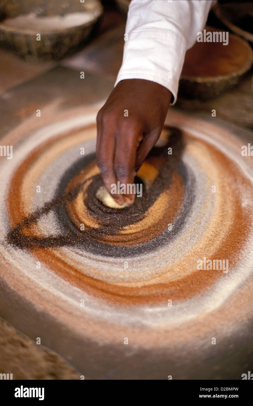 Senegal, Dakar - Man'S Hand Executing A Sand Painting - Stock Image