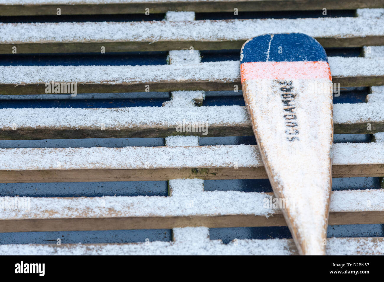 Close up of an oar or paddle in a Punt in the snow in winter on the River Cam Quayside Cambridge UK - Stock Image