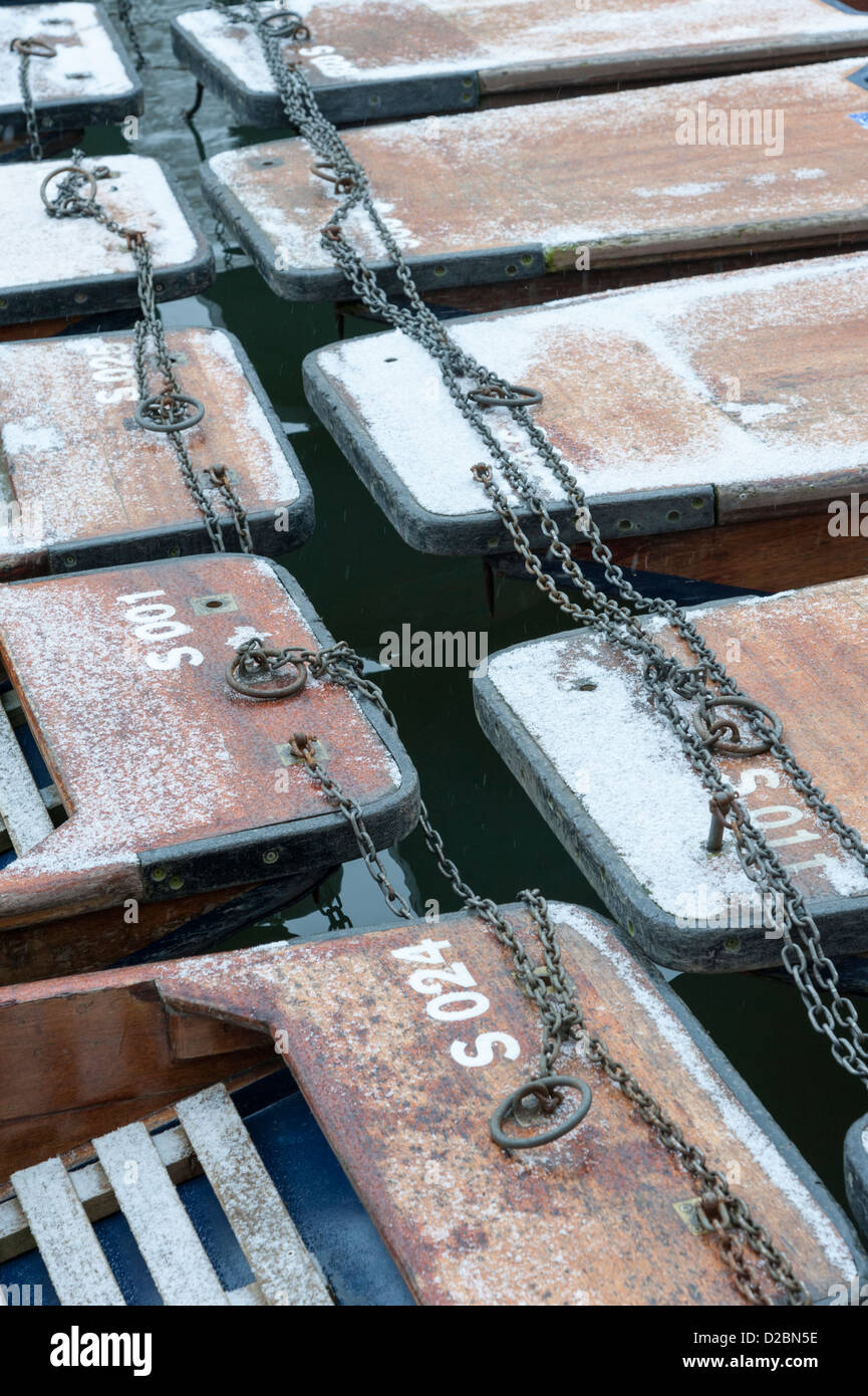 Punts in the snow in winter on the River Cam Quayside Cambridge UK Stock Photo
