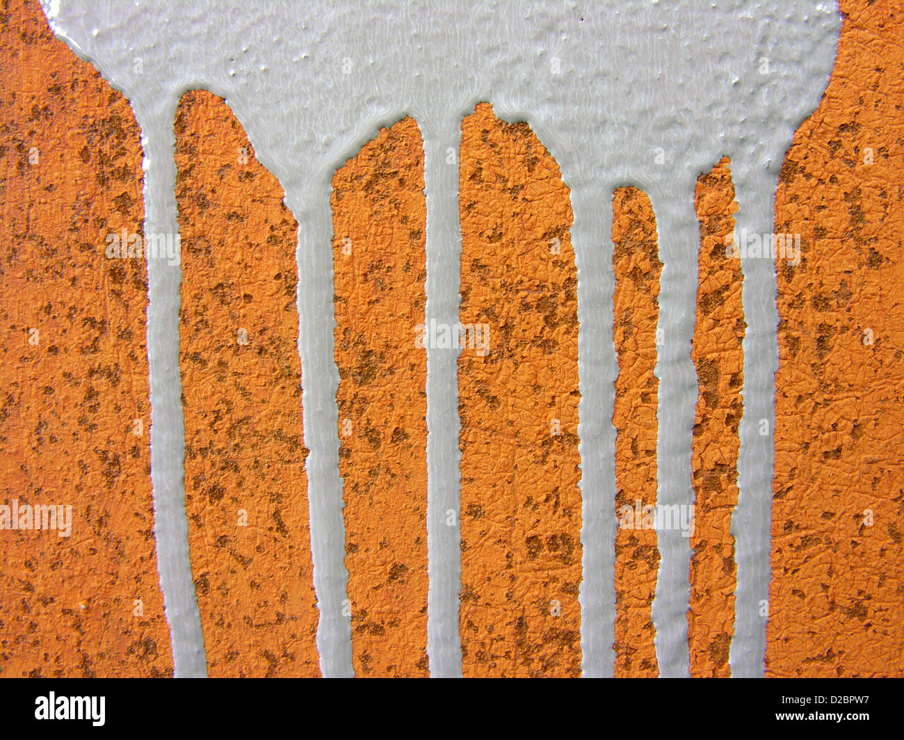 Old rusty metal surface with paint leaks - Stock Image