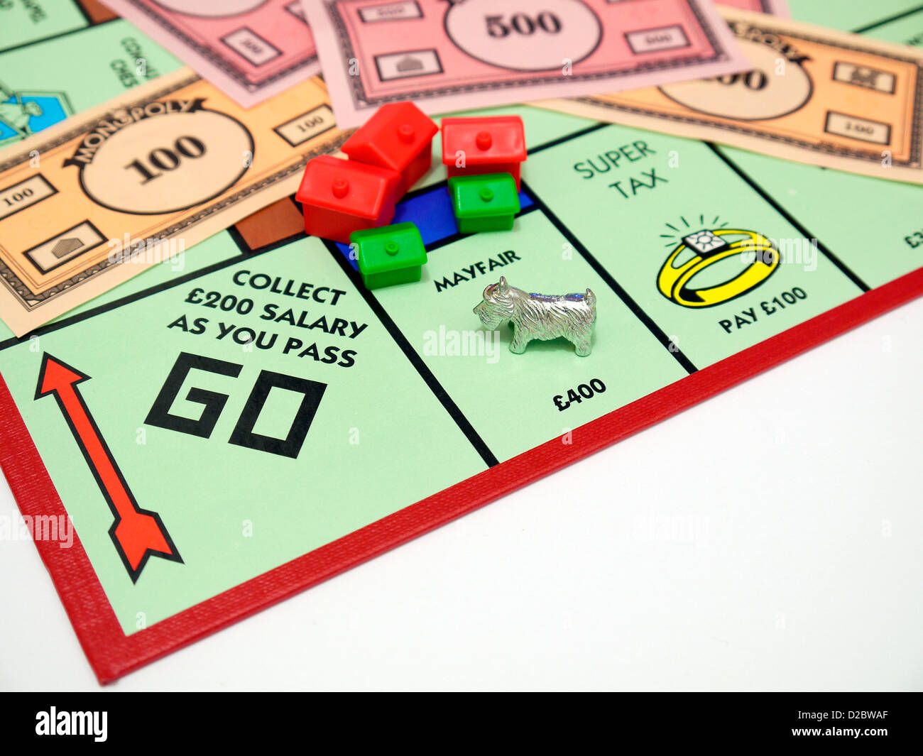 A Monopoly Token landing on Mayfair - representing someone unable to pay bills - Stock Image