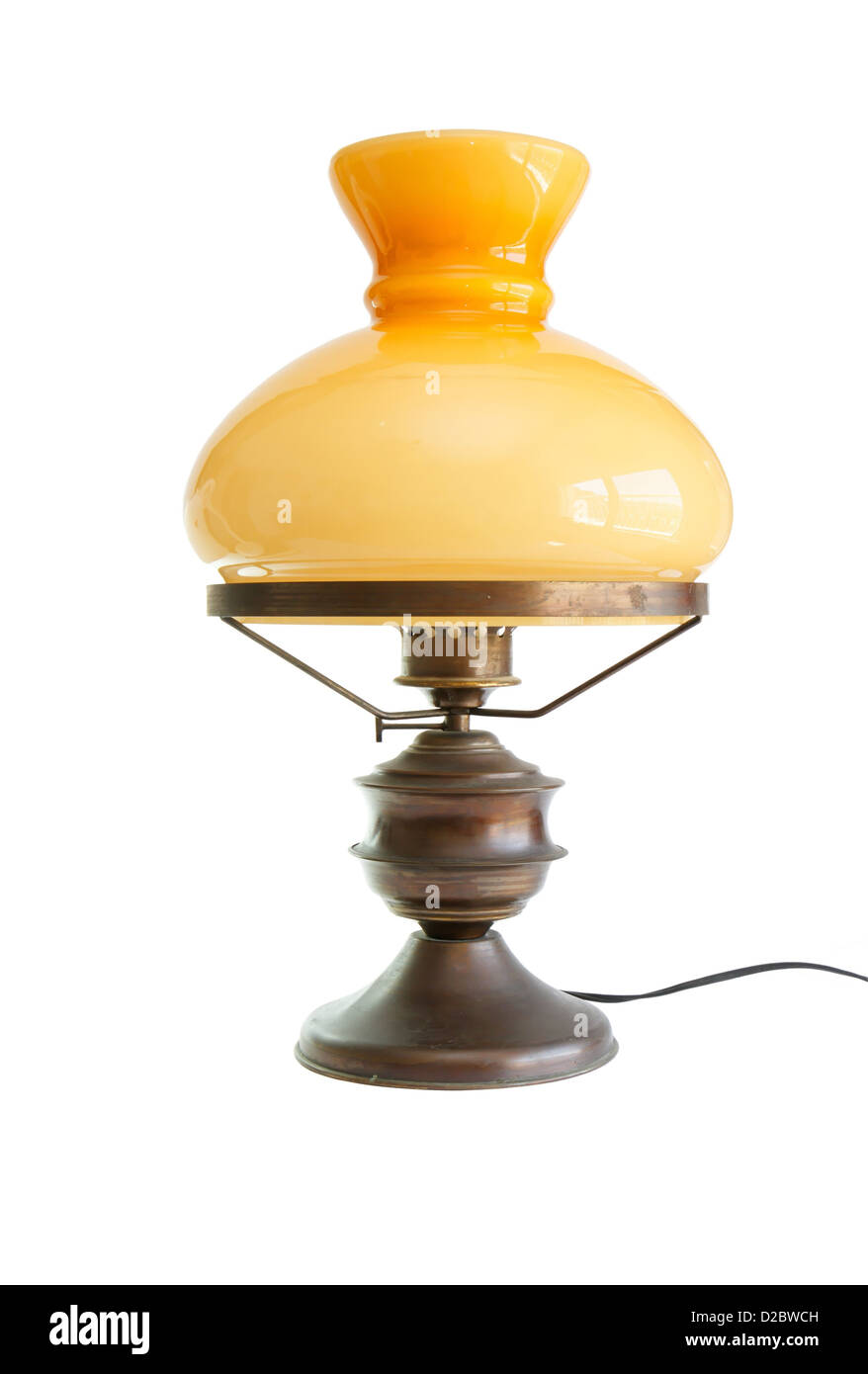Table lamp stylized as antique oil lamp isolated - Stock Image