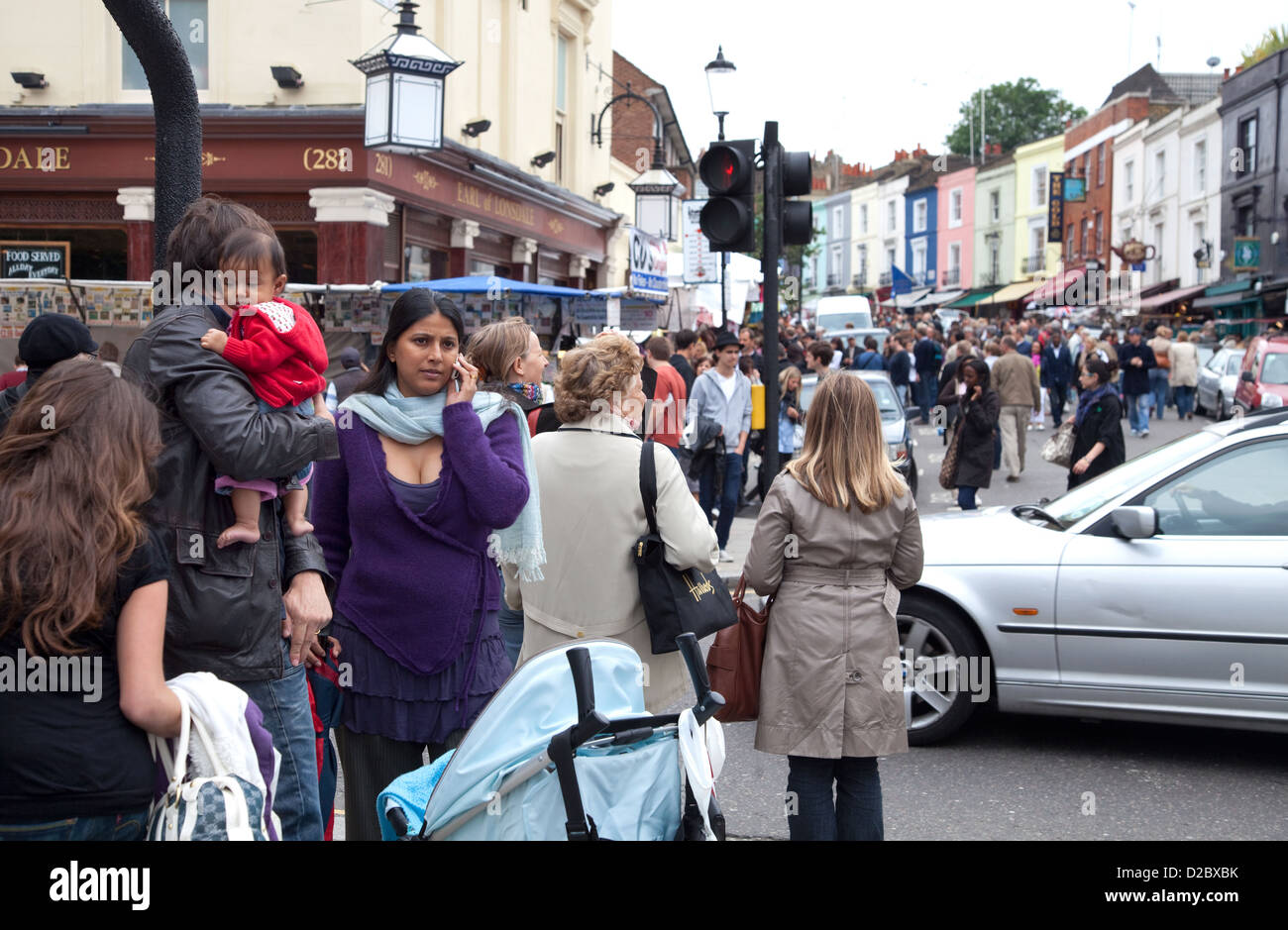 London, UK, passersby on the Portobello Road in Notting Hill - Stock Image