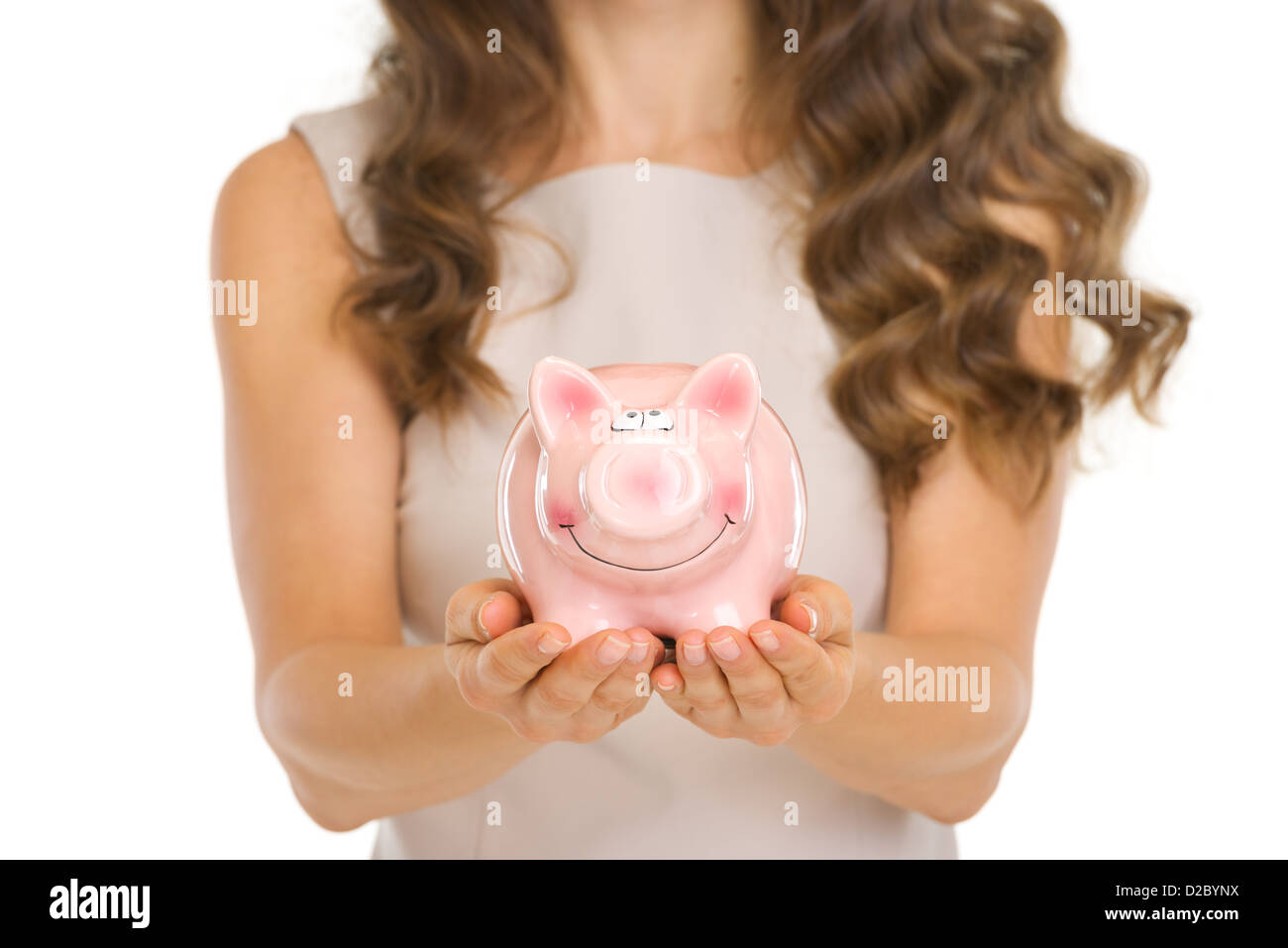 Closeup on piggy bank in woman hands - Stock Image
