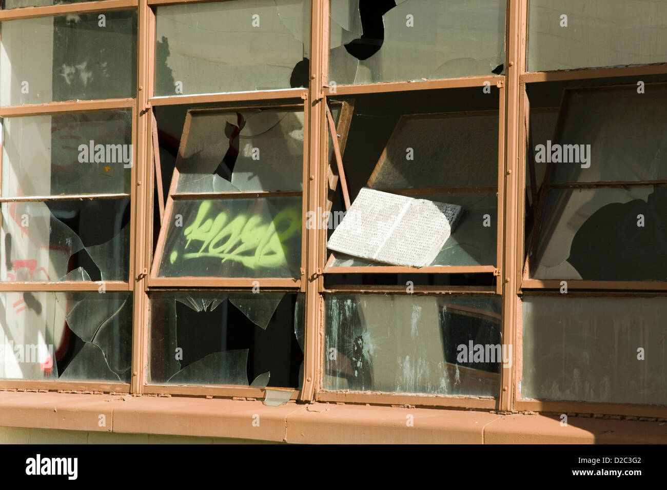 A broken window in an abandoned building on the old military base of Fort Ord in California. - Stock Image