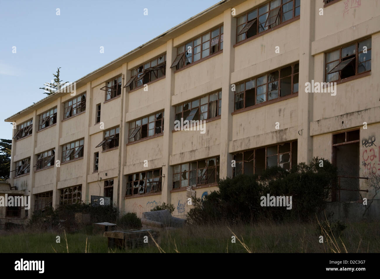 A vandalized abandoned building at Fort Ord, in Seaside, California.  This was once a thriving military base. - Stock Image
