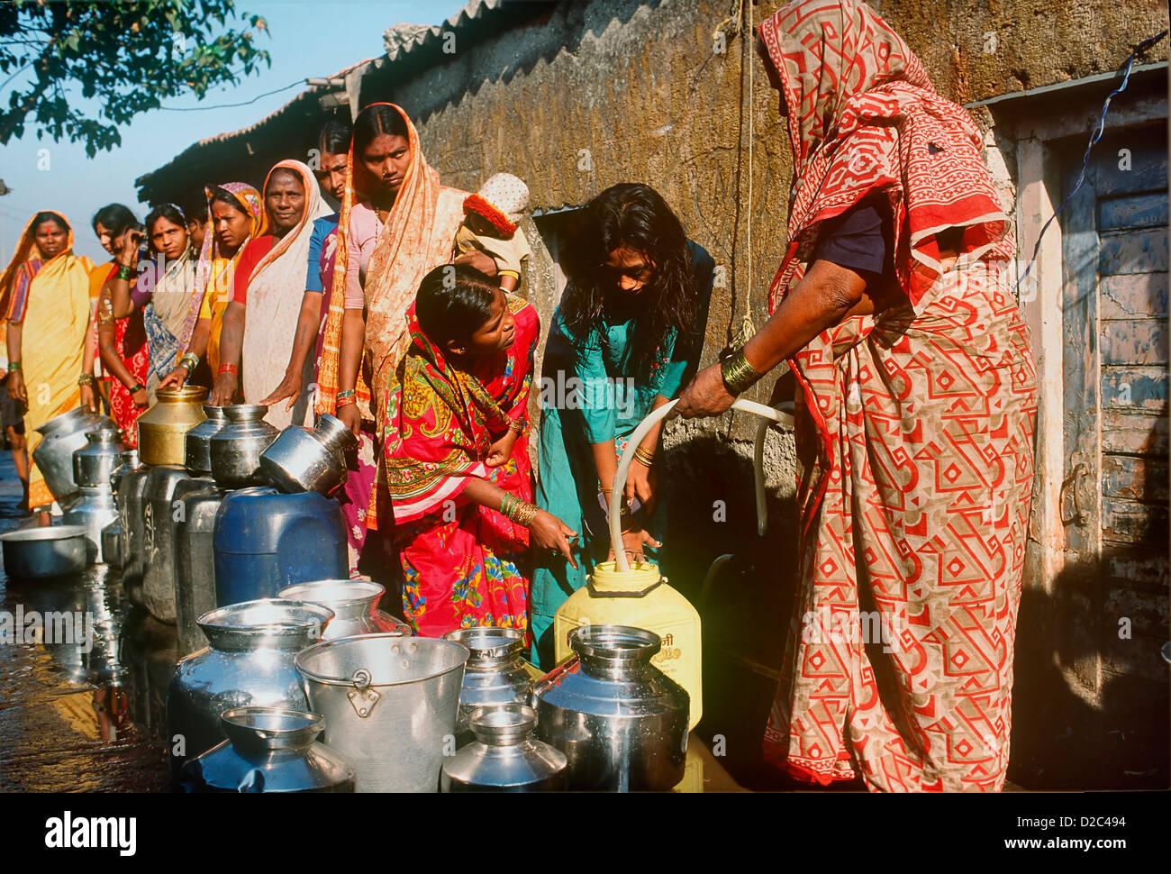 Rwomen Queuing Up In Slum Their Vessels Collect Their Daily Requirement Water Community Tap Mumbai (Bombay) India - Stock Image