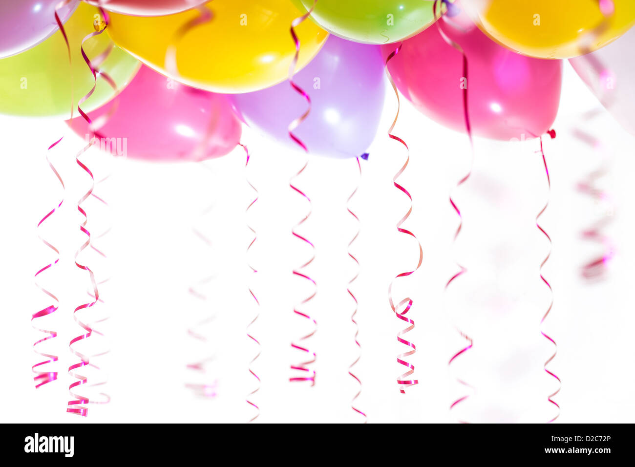 balloons with streamers for birthday party celebration isolated on white background - Stock Image