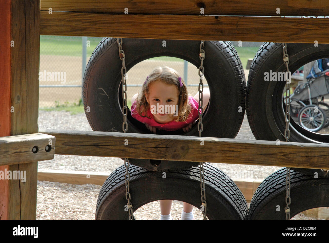 41/2 -Yr. Old Girl, Tires, Playground - Stock Image