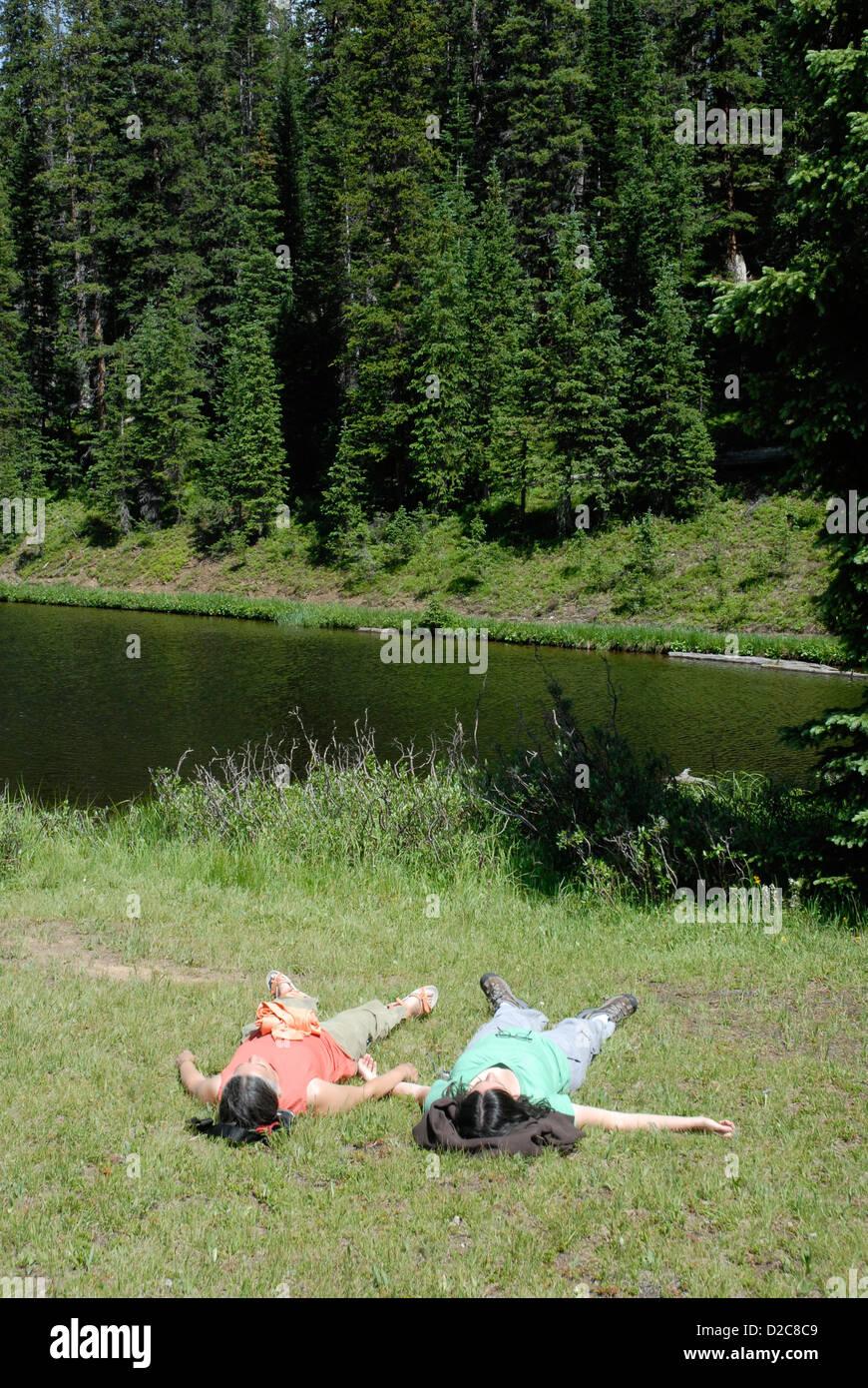 Women Sunbathing, Ignoring Ultraviolet Warnings, Lake Irene, Rocky Mt. National Park, Colorado - Stock Image