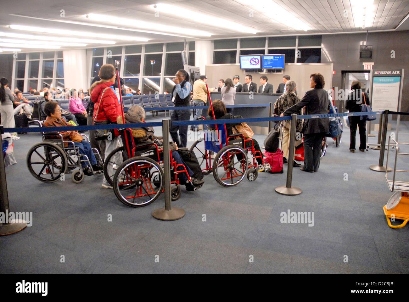 Wheelchairs At Airport Gate, Jfk International Airport, New York - Stock Image
