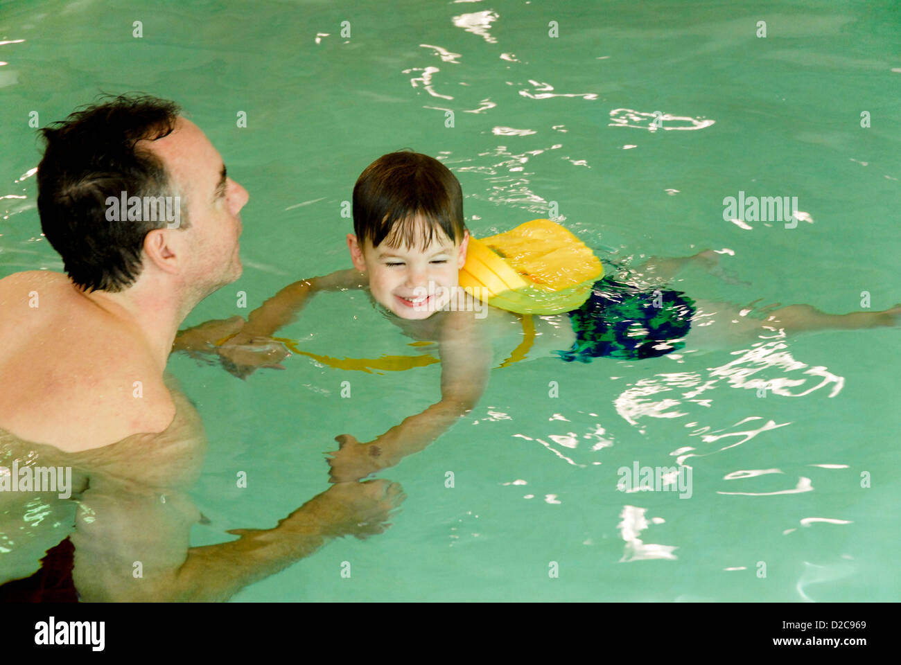 Father And 2 1/2-Year Old Son, Massachusetts, Swimming Lessons - Stock Image