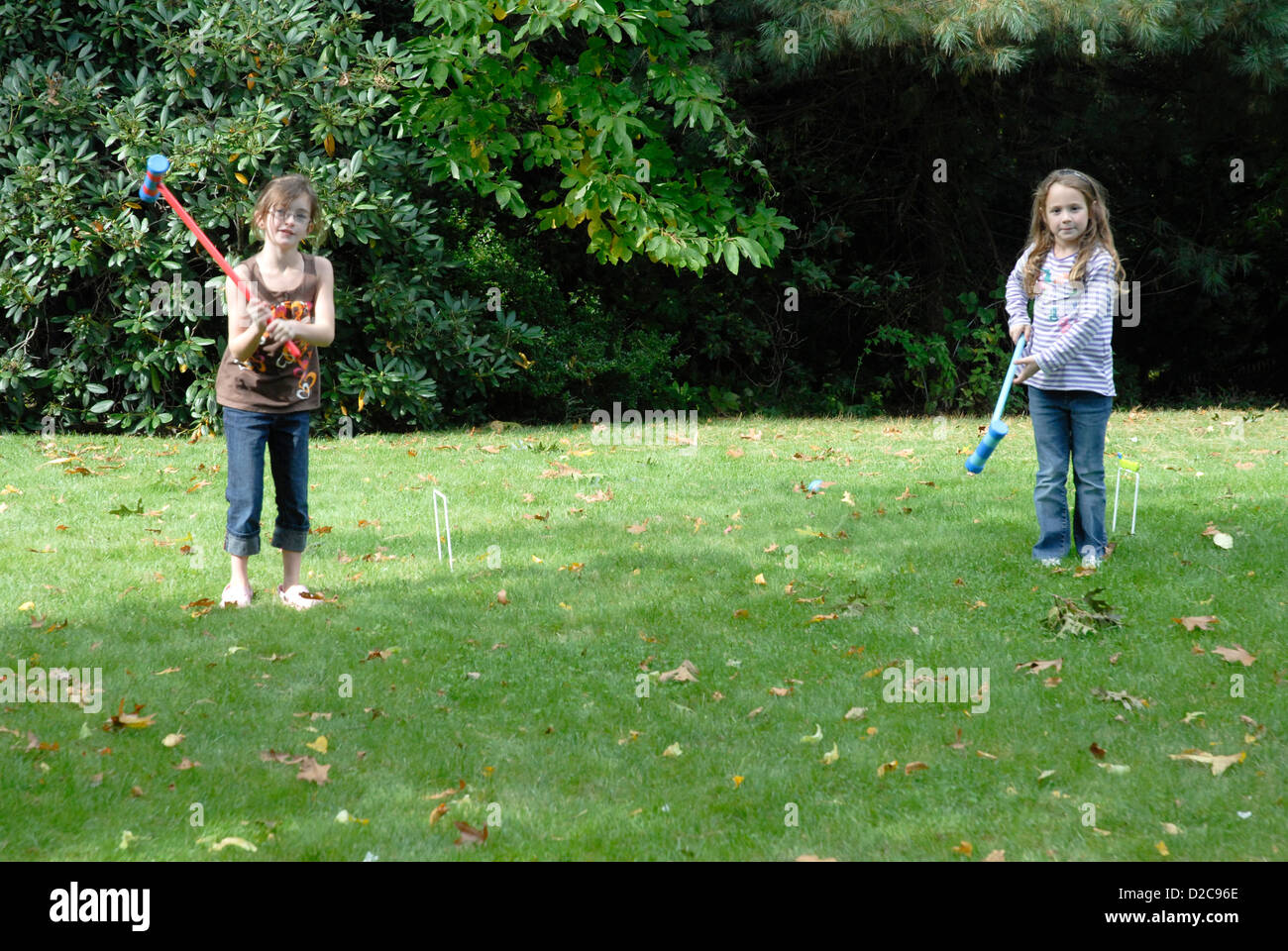 7-Year Old Girls, Winchester, Massachusetts, Playing Croquet - Stock Image
