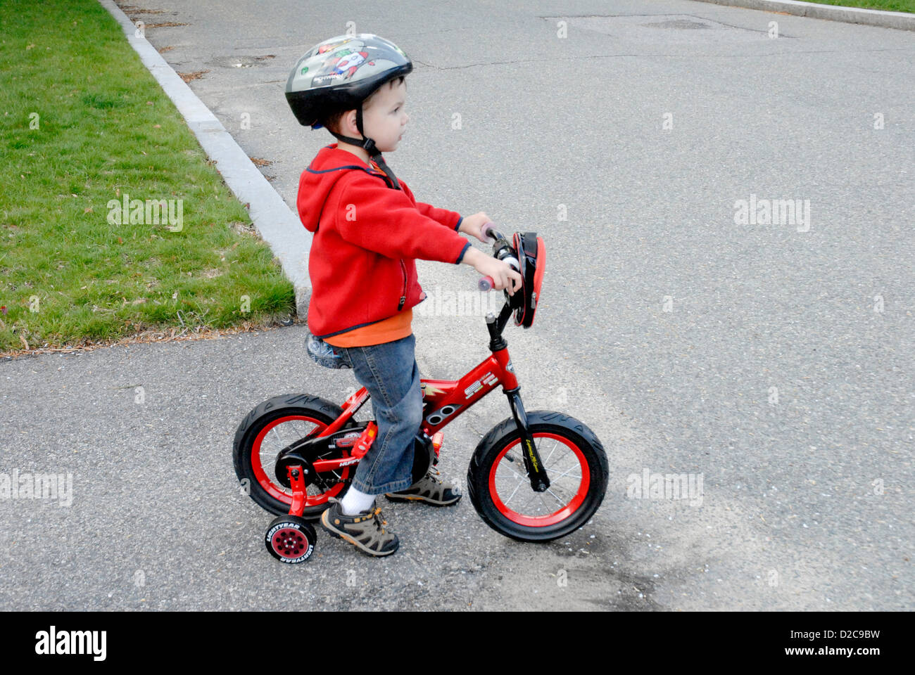 3-Year-Old Boy, Winchester, Massachusetts. Bike With Training Wheels - Stock Image