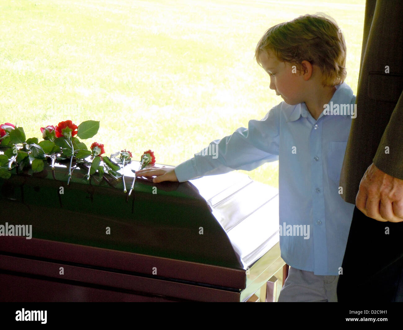 6-Year-Old Boy At Funeral - Stock Image