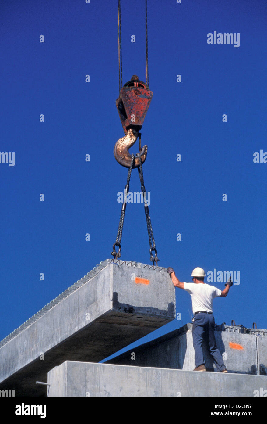 Large Metal Beams Being Moved By Crane At Construction Site - Stock Image