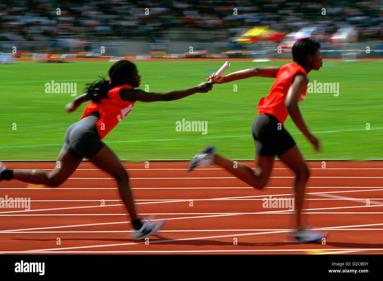 Track & Field. Runners In A Relay Race, Passing Baton - Stock Image
