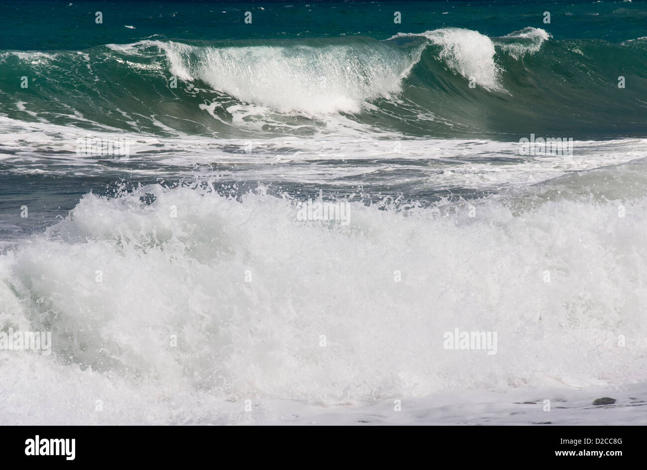 Aegean waves breaking ashore - Stock Image