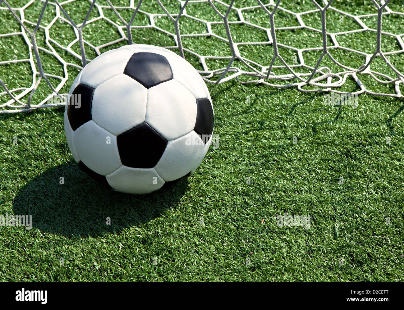 Soccer ball on the field in the grid - Stock Image