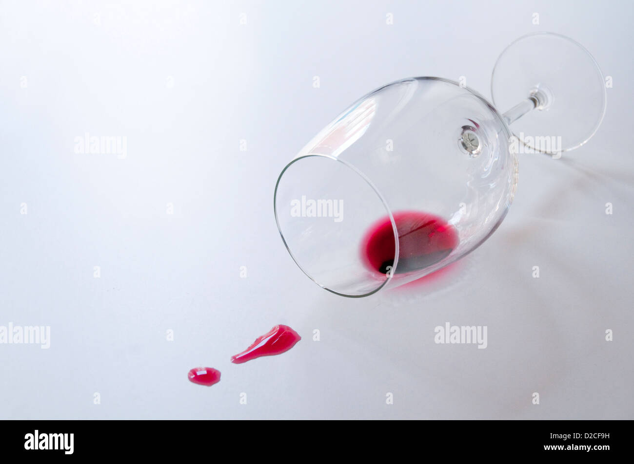Knocked over glass and split wine. Stock Photo