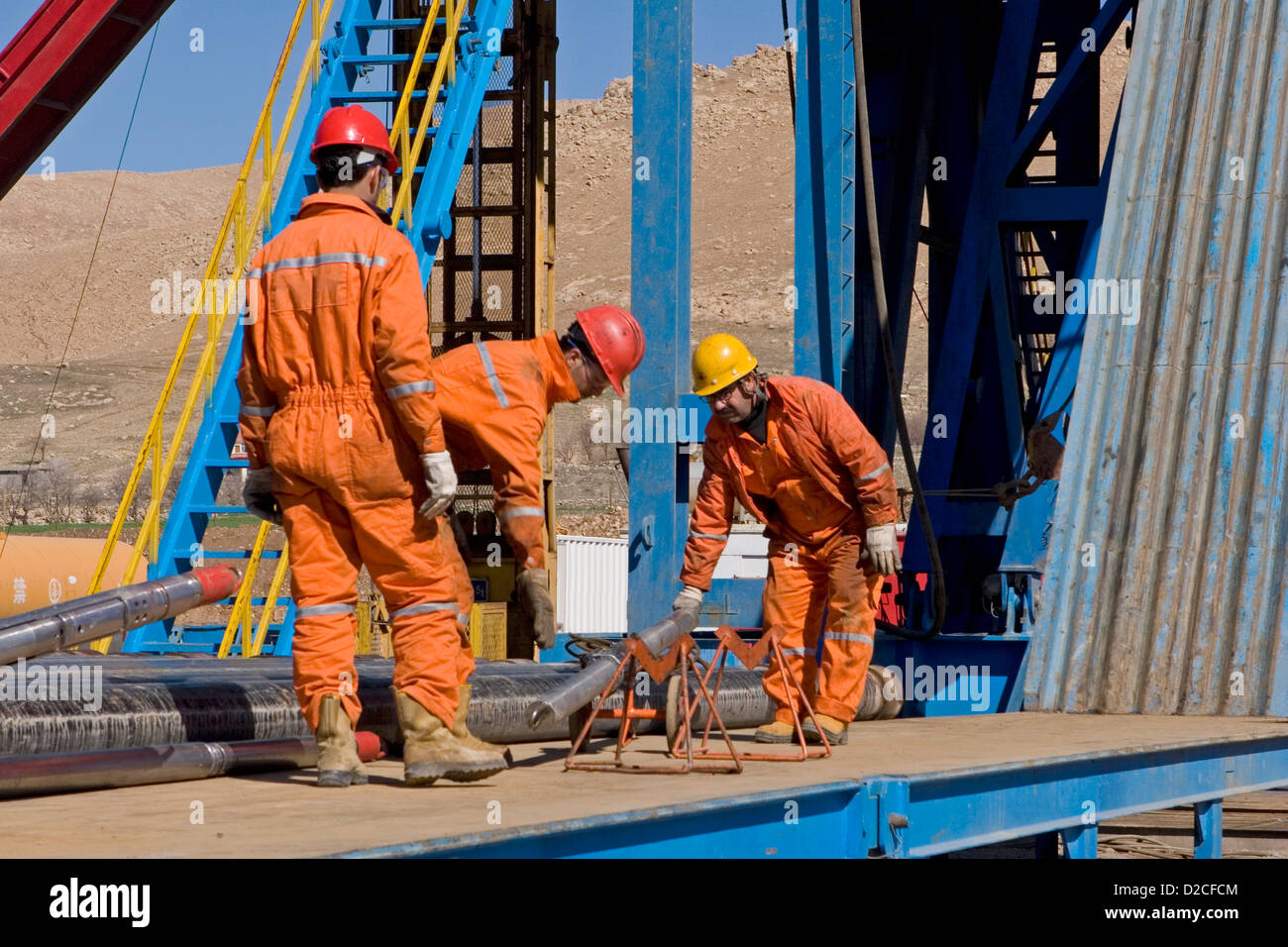 Onshore oil and gas exploration site. Making up wire line logging tools before lifting up to rig platform floor. - Stock Image