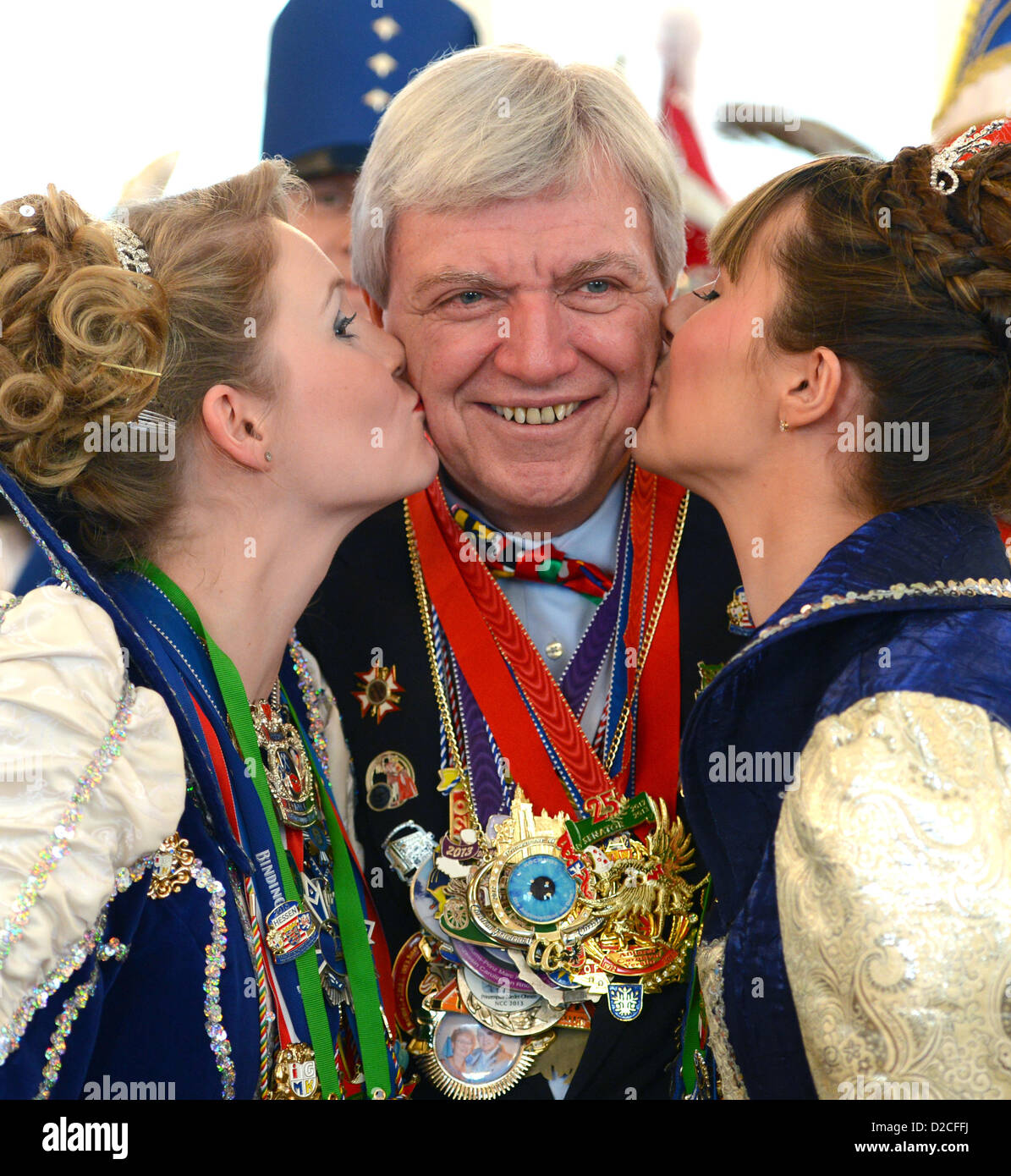Hesse's Premier Volker Bouffier is kissed by Princess Ina I. (L) of Homburger Lachenden Herzen (Bad Homburg) - Stock Image