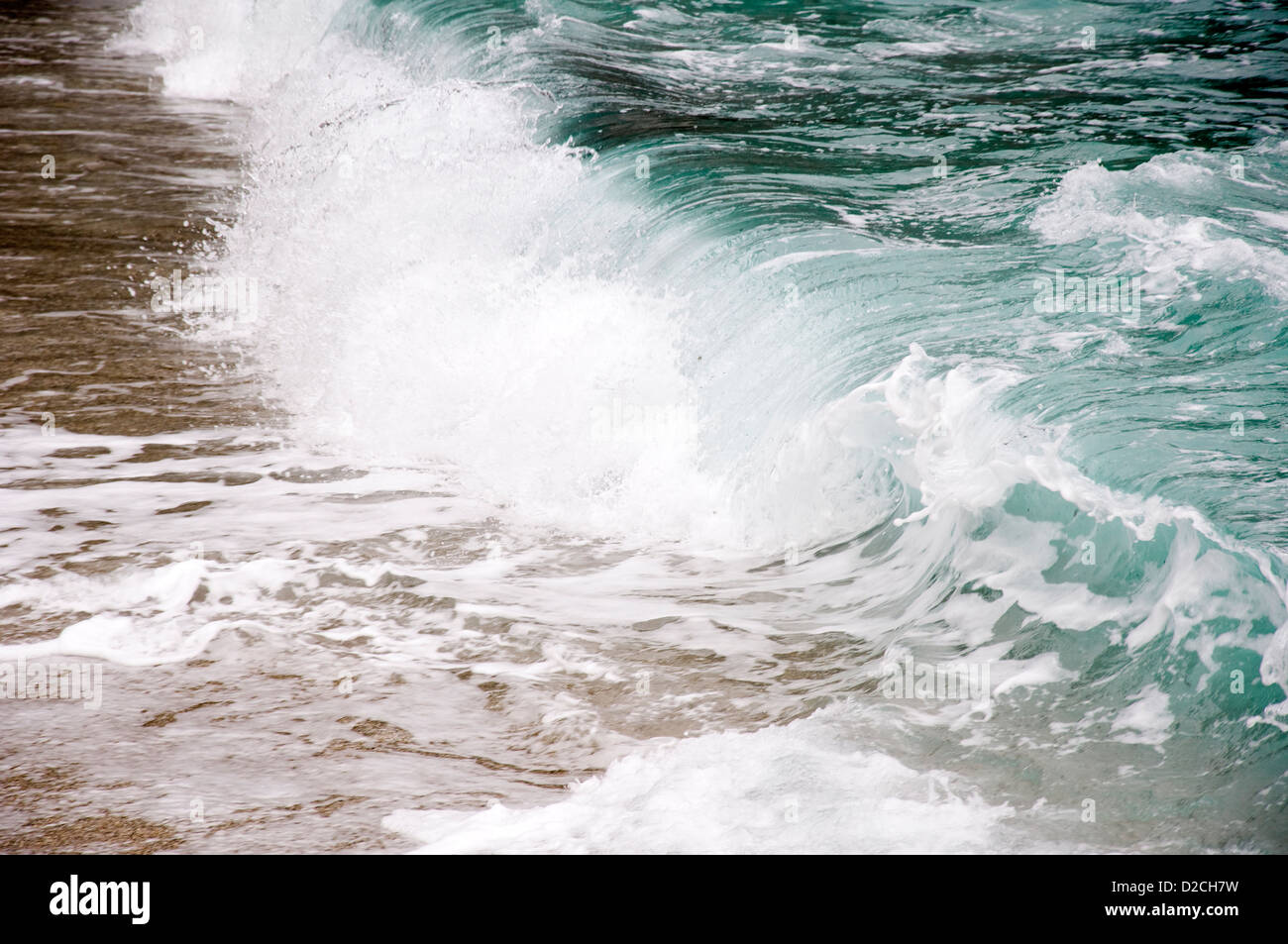 Wave on Aegean beach - Stock Image