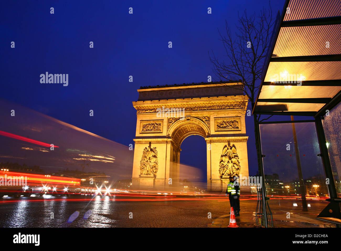 traffic paris place de l etoile and arc de triomphe at night stock