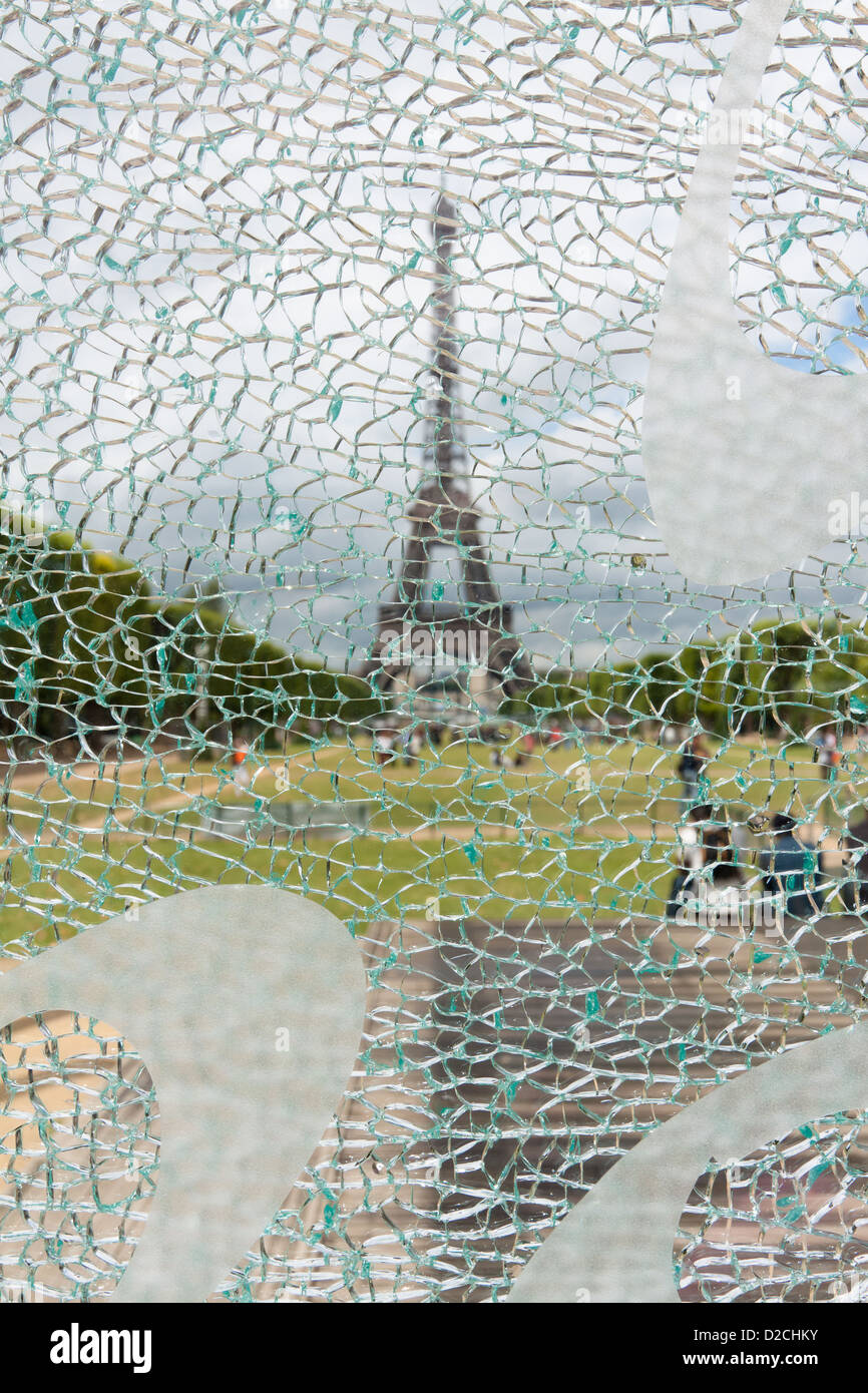 Eiffel Tower through the cracked glass - Stock Image