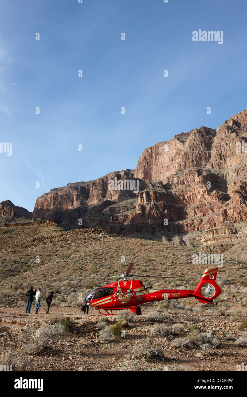 passengers leaving on helicopter tour landed on pad down in the Grand canyon Arizona USA - Stock Image