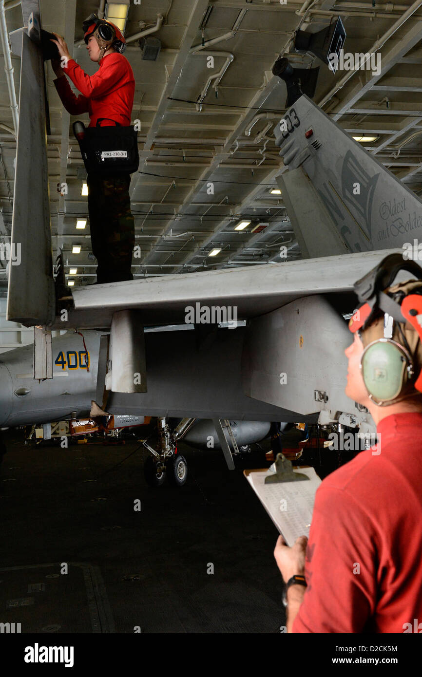 Aviation Ordnanceman Airman Dallas Hall, from Goesbeck, Texas, left, performs inventory on an F/A-18E Super Hornet - Stock Image