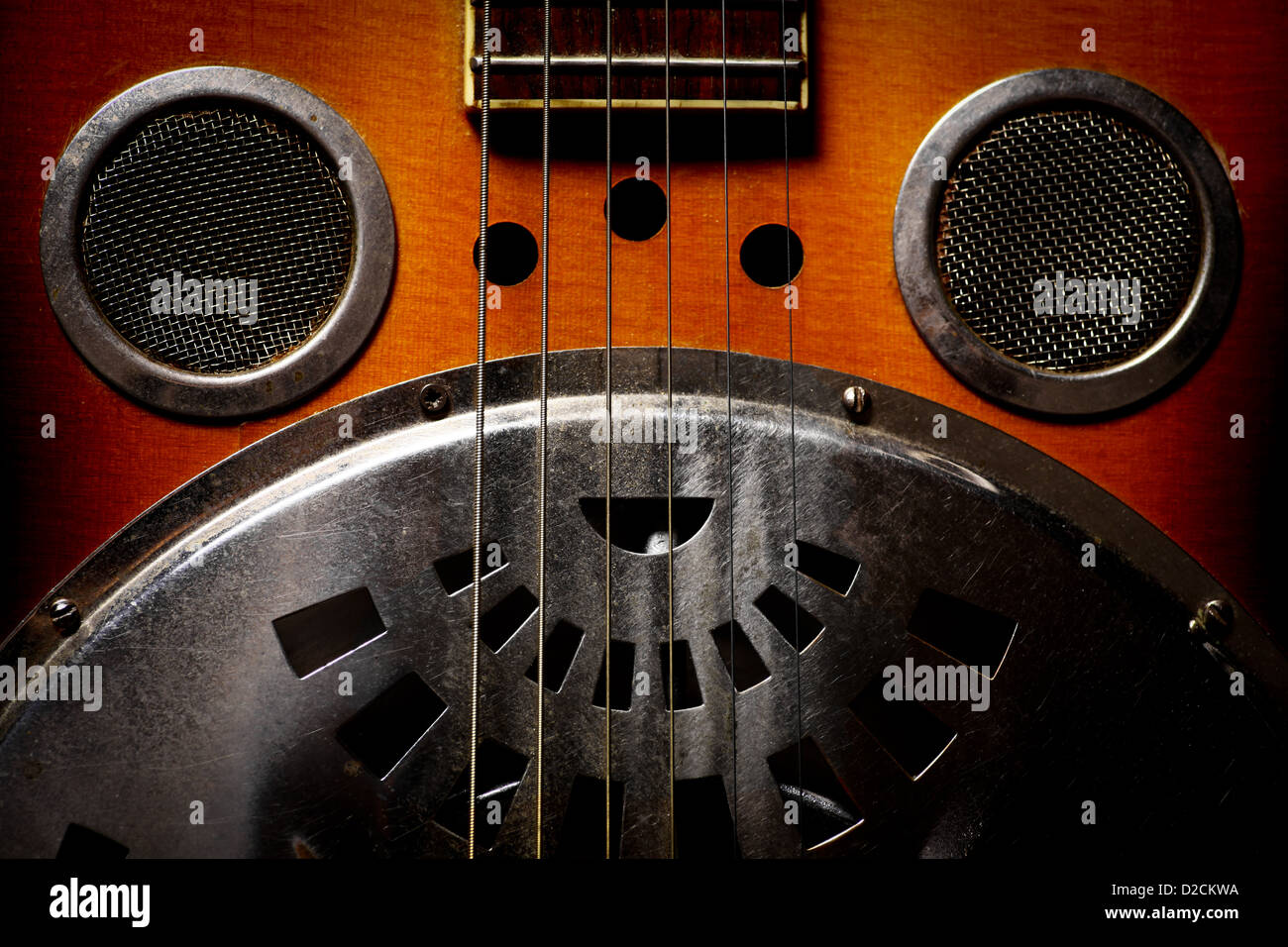 Color shot of a vintage dobro guitar - Stock Image