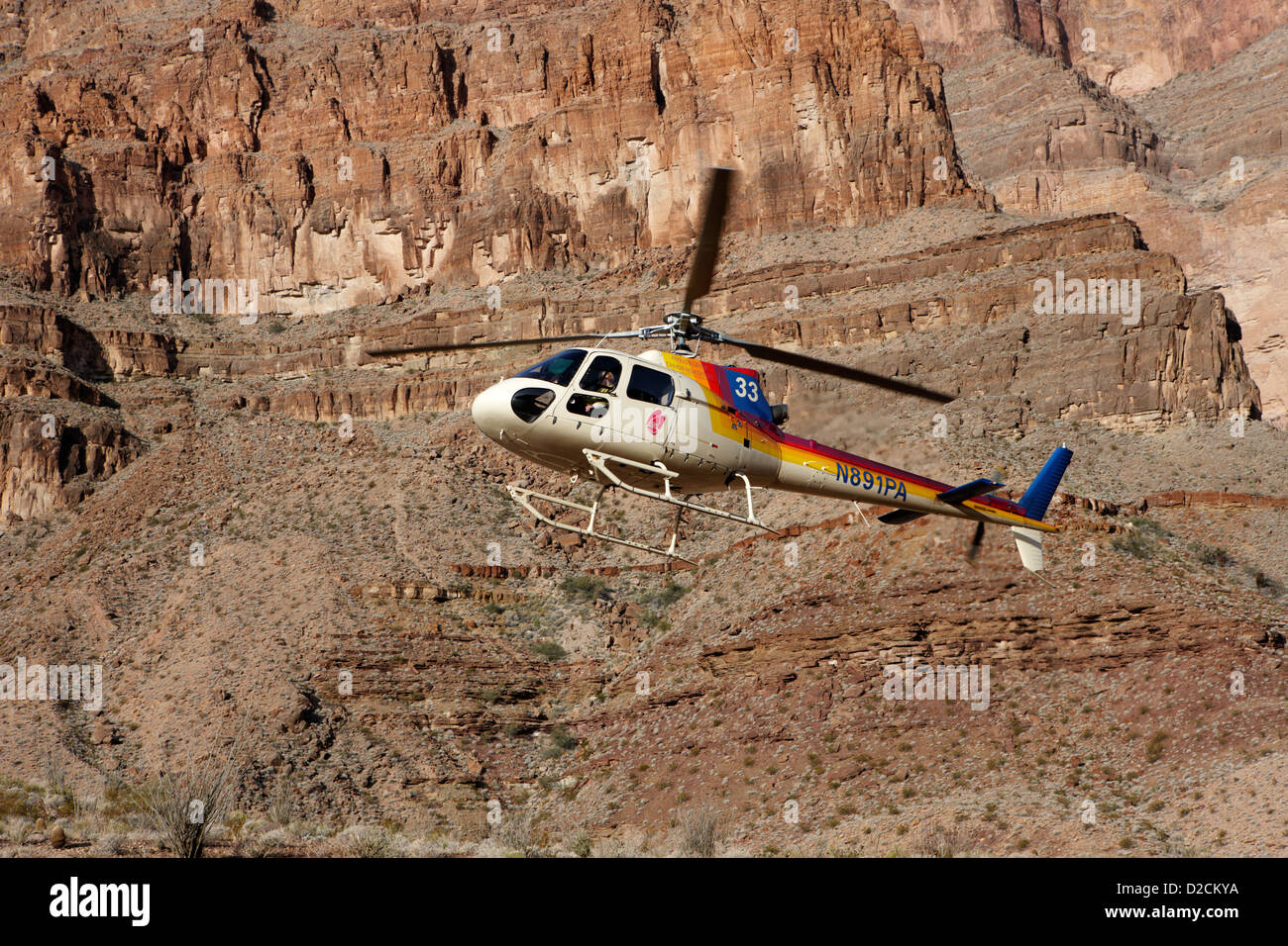papillon helicopter tours coming in to land pad down in the Grand canyon Arizona USA - Stock Image