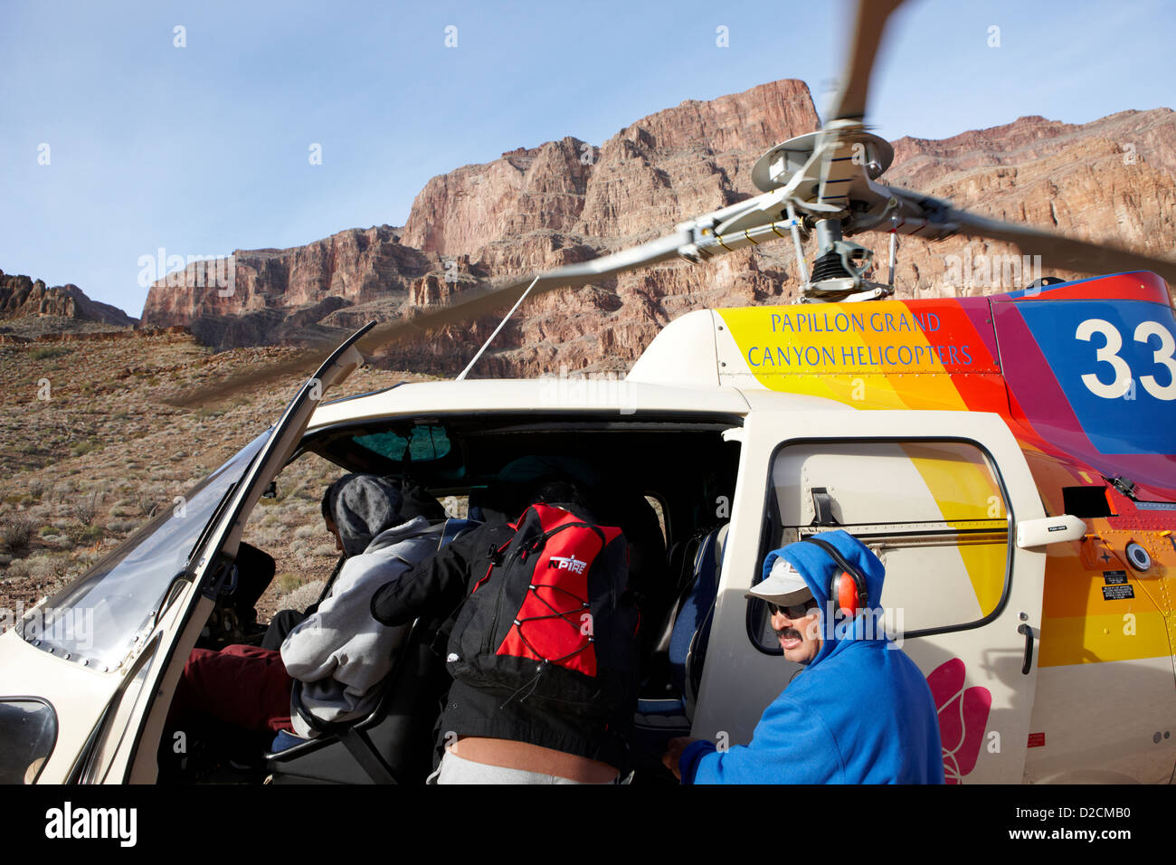 passengers getting on papillon helicopter tours landed on pad down in the Grand canyon Arizona USA - Stock Image