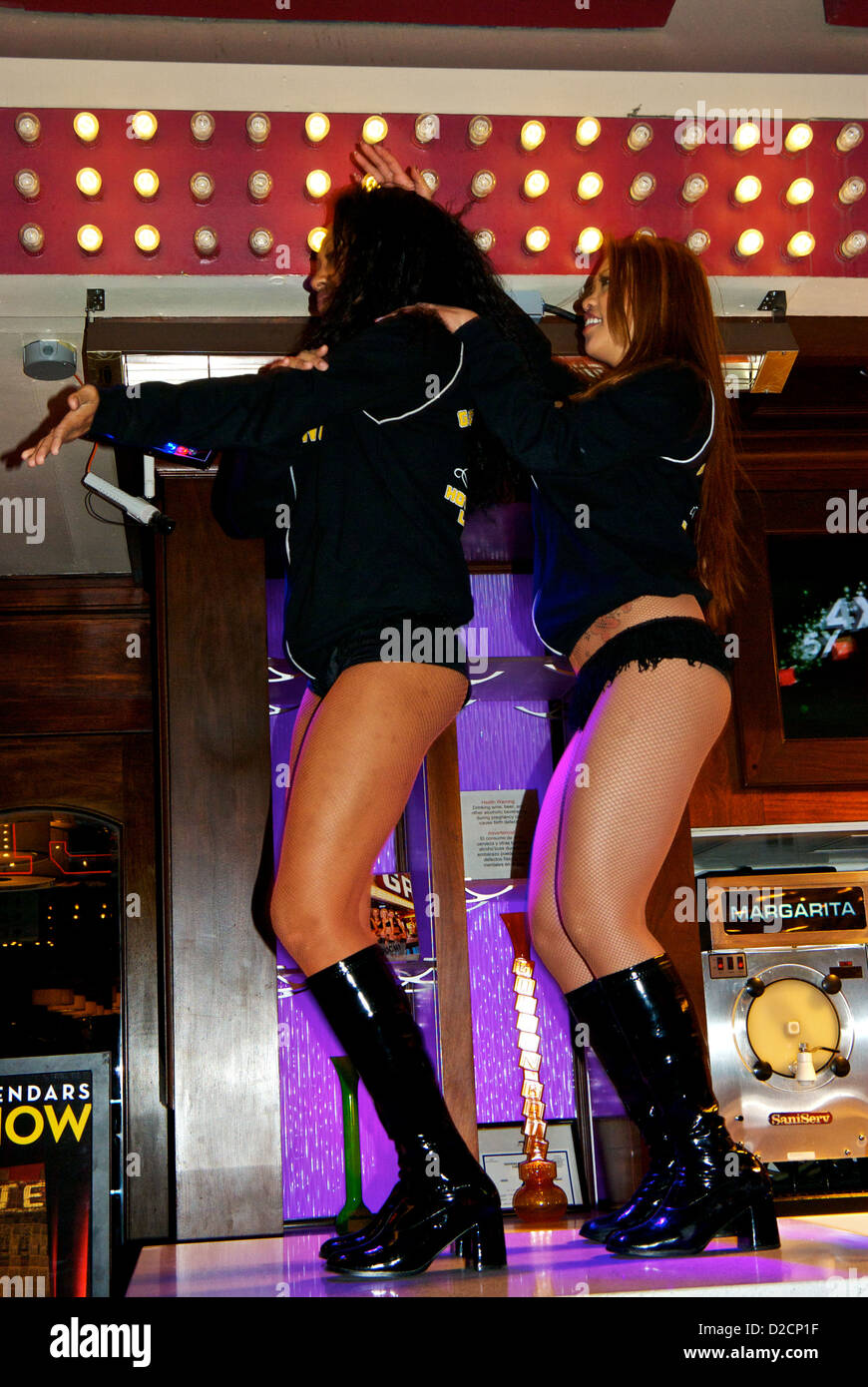 Showgirls dancing Macarena outside Golden Gate Hotel bar Fremont Street Experience old Las Vegas downtown - Stock Image