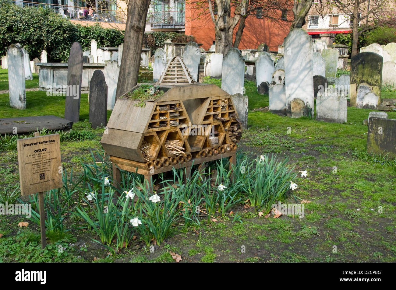 Invertebrate Bug Hotel or Insect House  situated amongst gravestones, Bunhill Fields Burial Ground - Stock Image