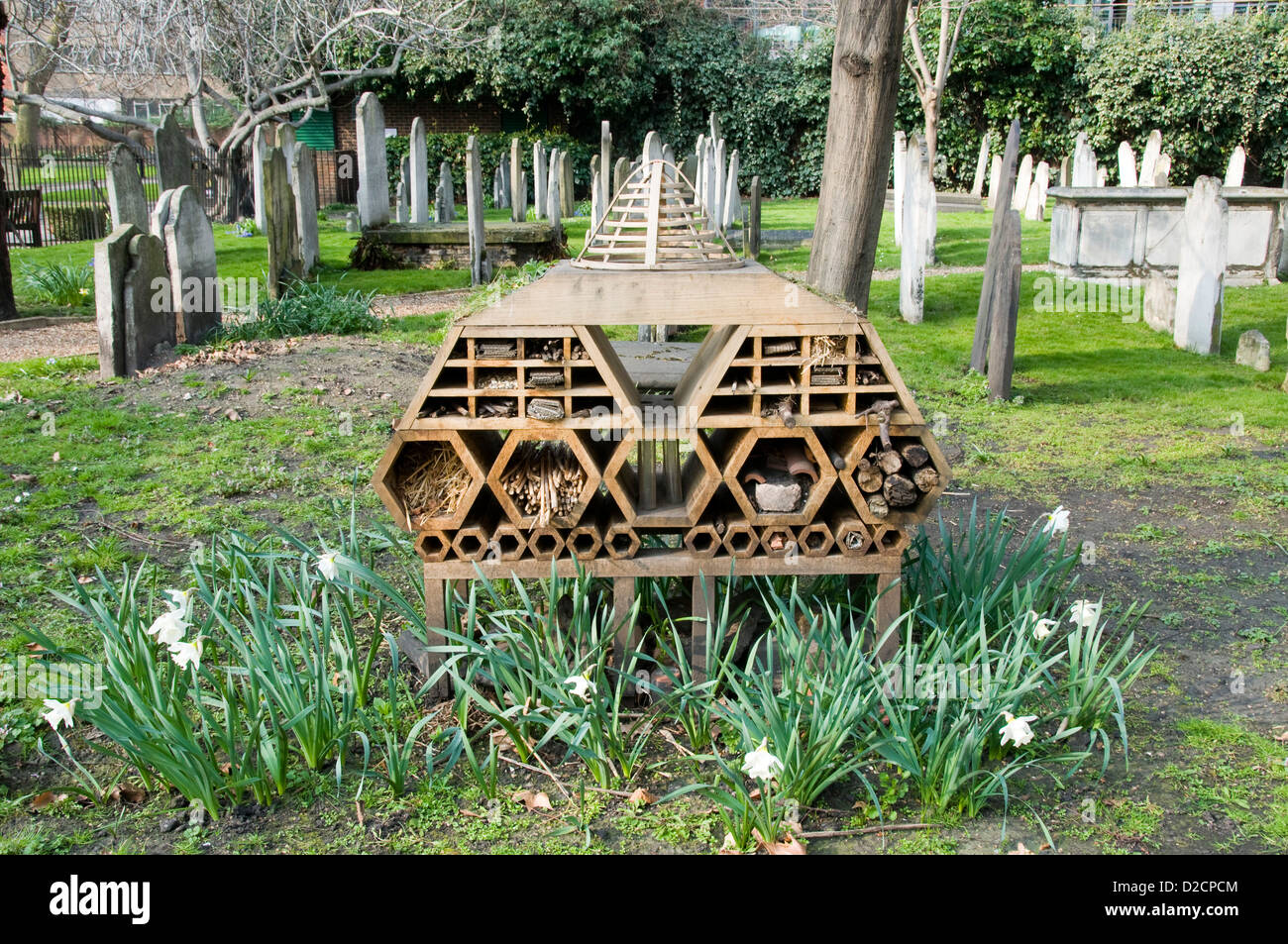 invertebrate Bug Hotel or Insect House  situated amongst gravestones, Bunhill Fields Burial Ground Stock Photo