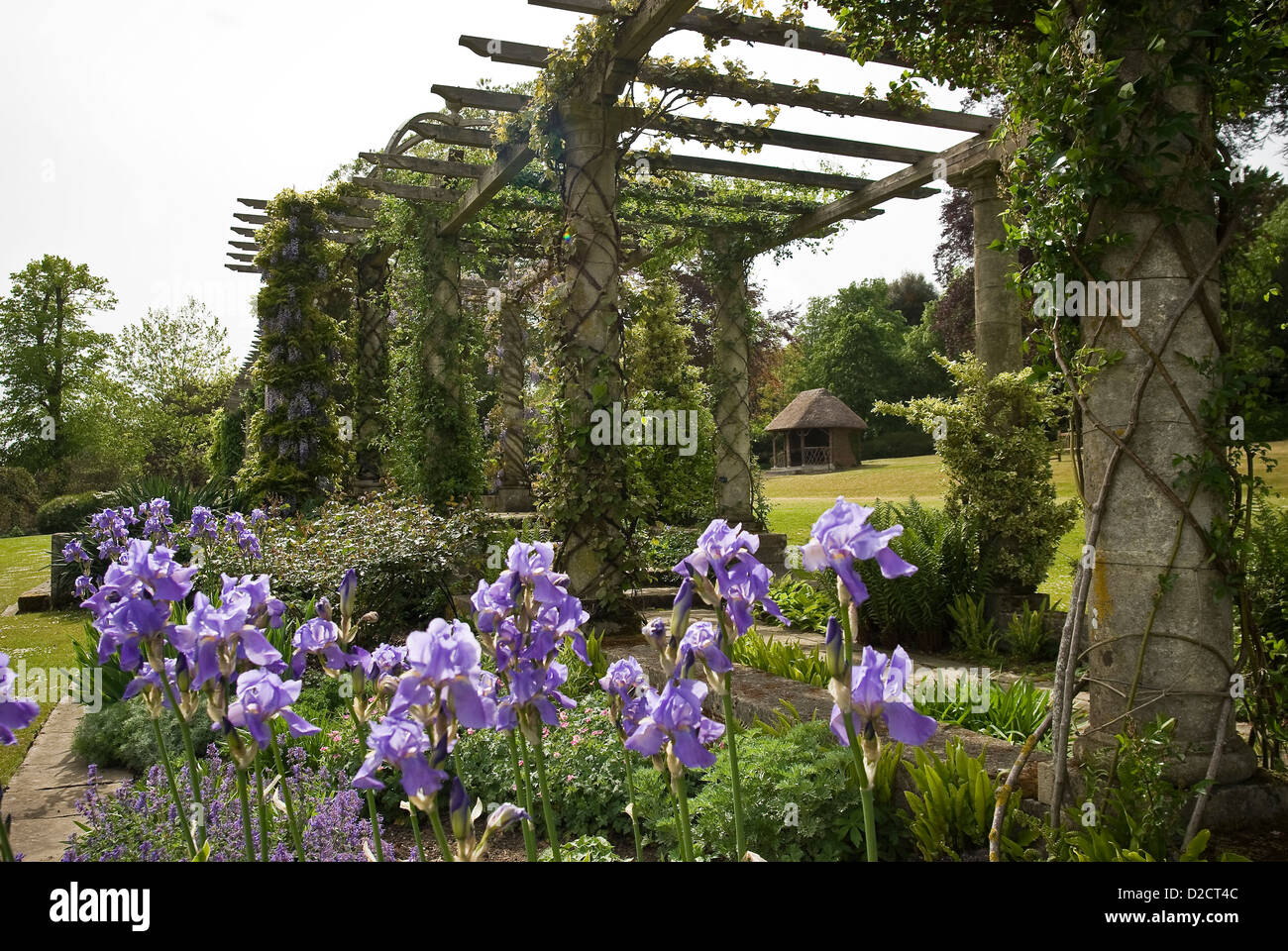 Wooden trellis or arbor and flowers at West Dean Gardens Chichester