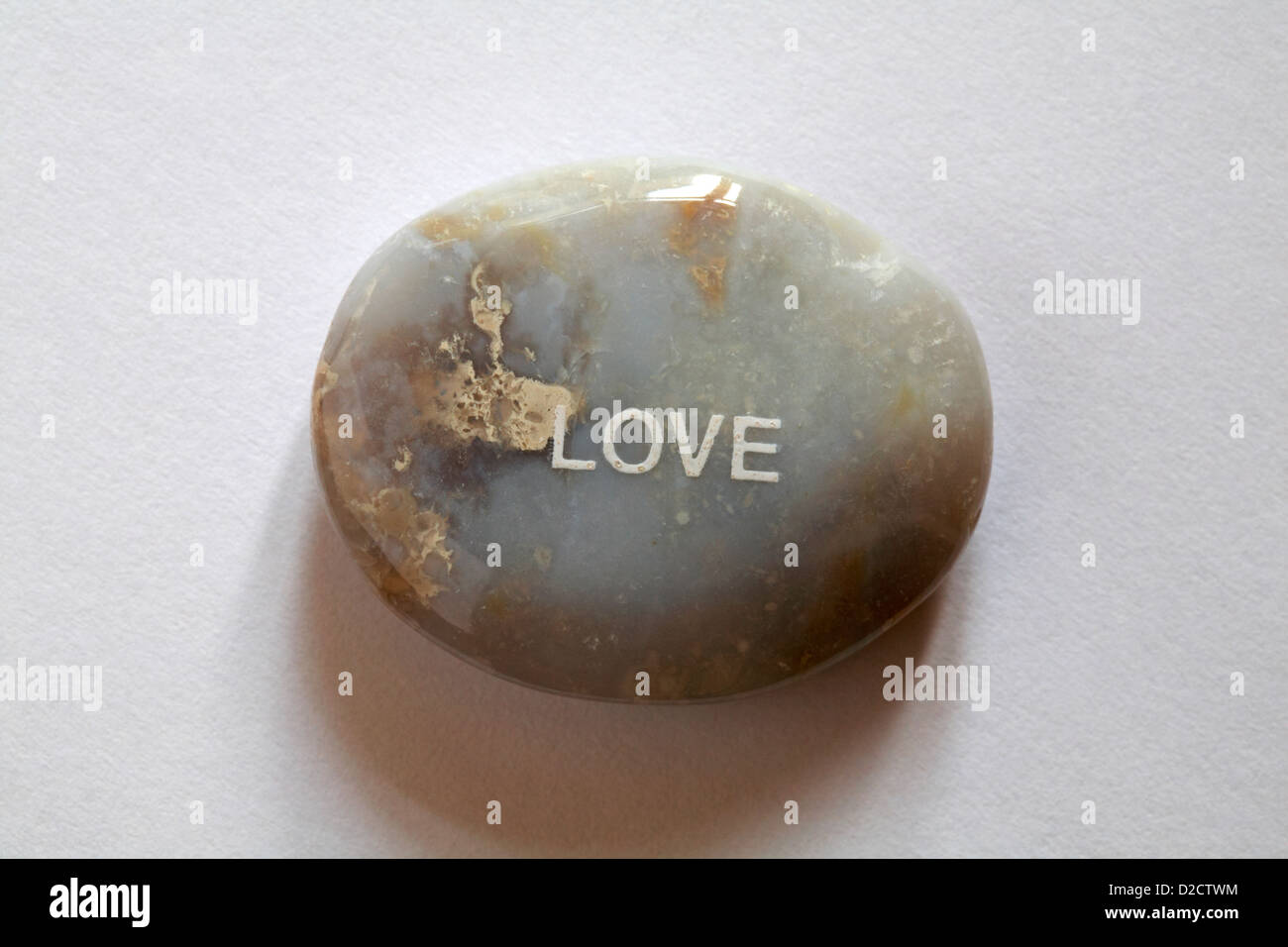 Fair Trade sentiment pebbles - Love pebble isolated on white background - Stock Image