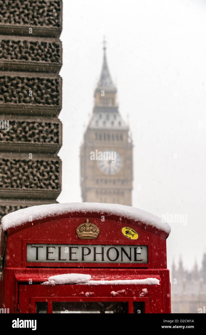 A red telephone box with the Big Ben in the background Parliament square Westminster London England Great Britain - Stock Image