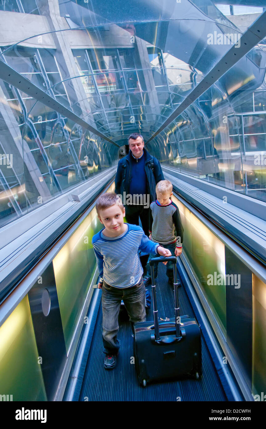 Family travelling in airport Charles De Gaulle, Paris, France - Stock Image