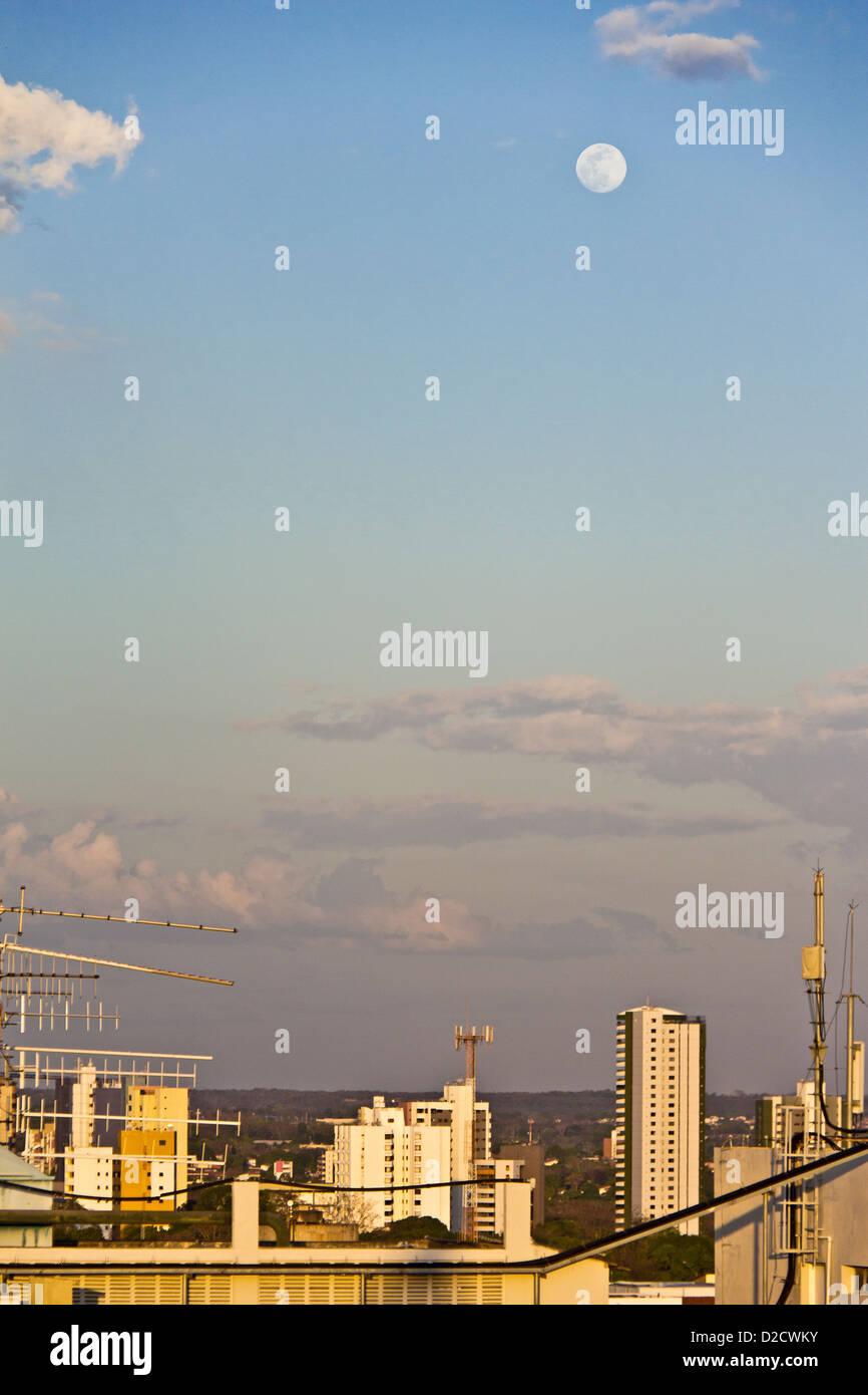 Moon seen suring daytime above the colorful skyline of Teresina, Piaui, Brazil - Stock Image