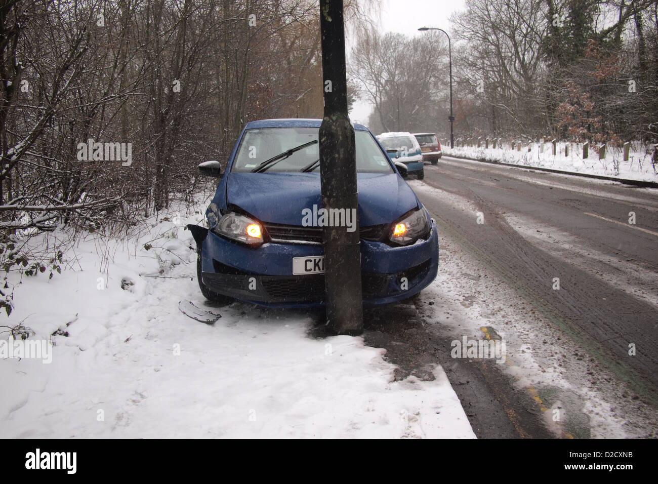 car crash accident in winter snow London UK england - Stock Image