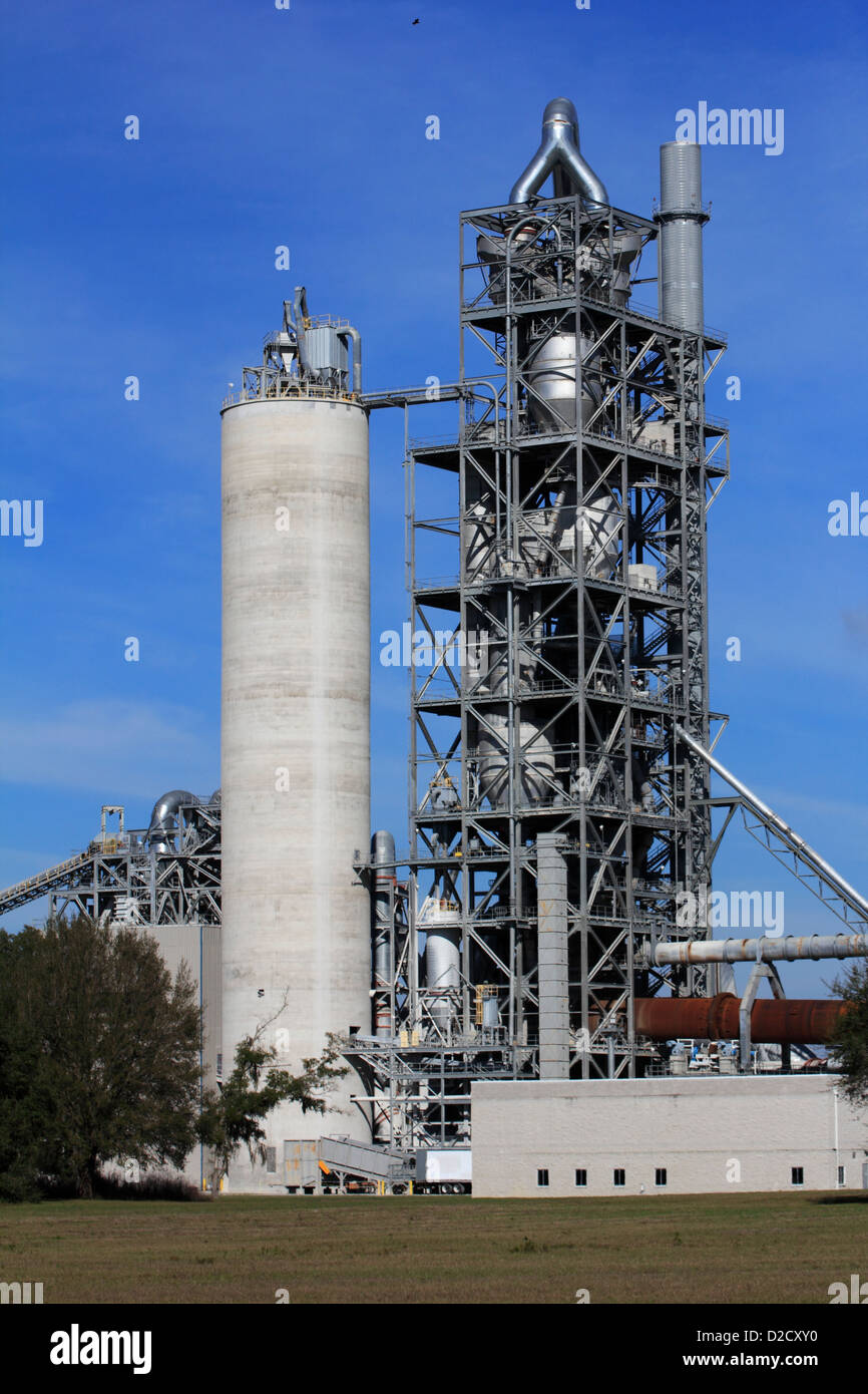 heavy industry industrial complex cement plant factory in the USA showing exterior structures - Stock Image