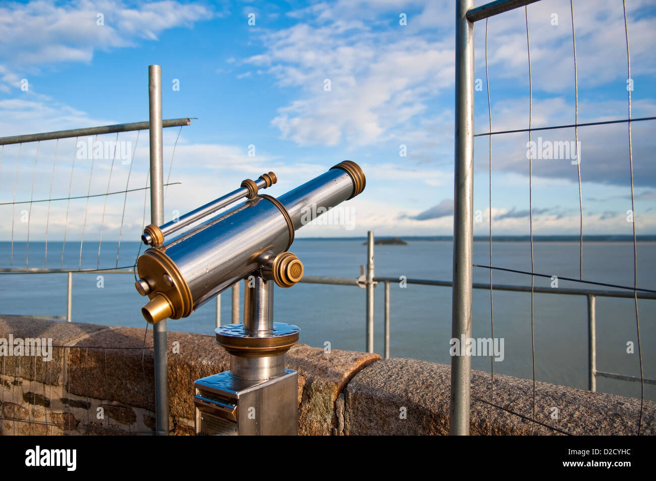 Telescope aiming Atlantic Ocean and island Tombelaine on view point on Mont Saint-Michel, France - Stock Image
