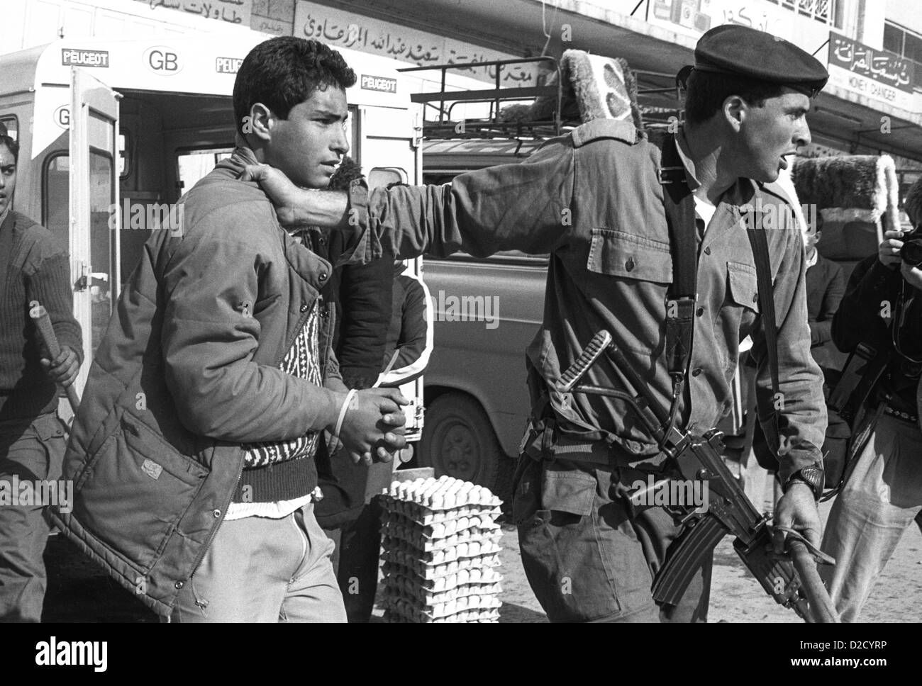 1988 Ramallah. Palestinian arrested for allegedly throwing stones at the beginning of the Palestinian Intifada. - Stock Image