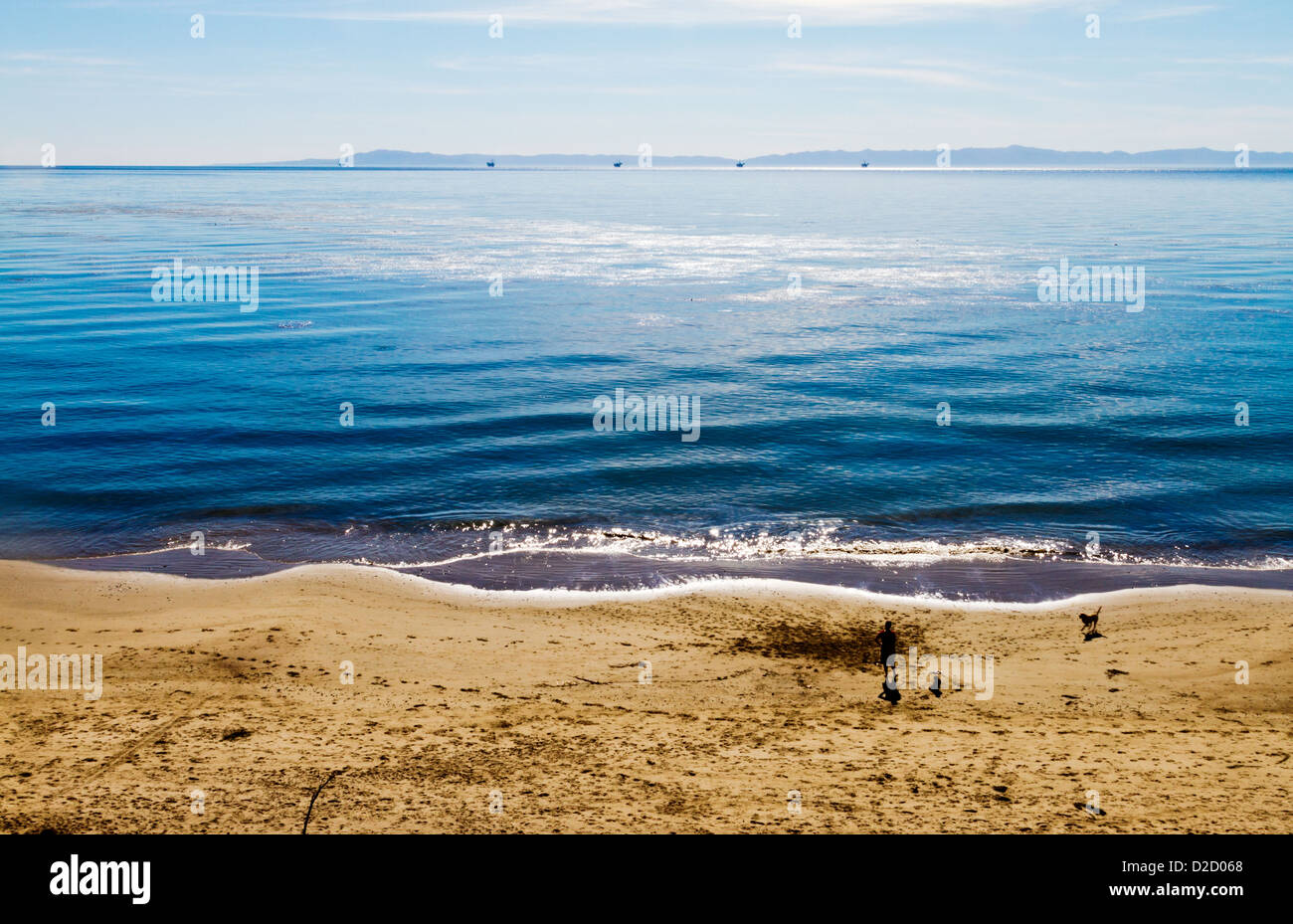 Man, child, and dog on a beach in Summerland, California - Stock Image