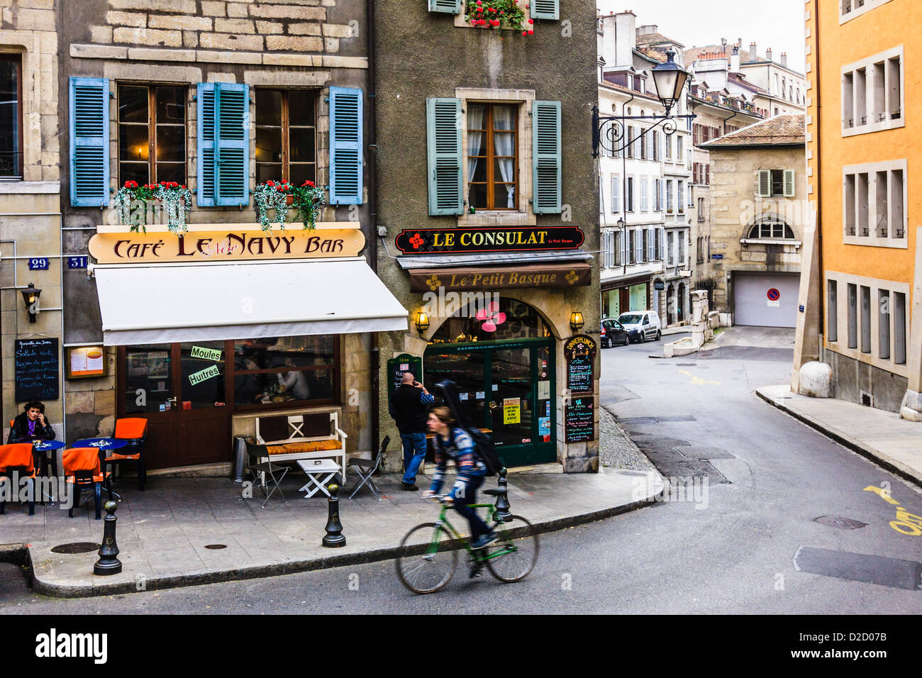 Cyclist and cafe bars at the Vieille Ville (Old Town) Geneva, Switzerland - Stock Image