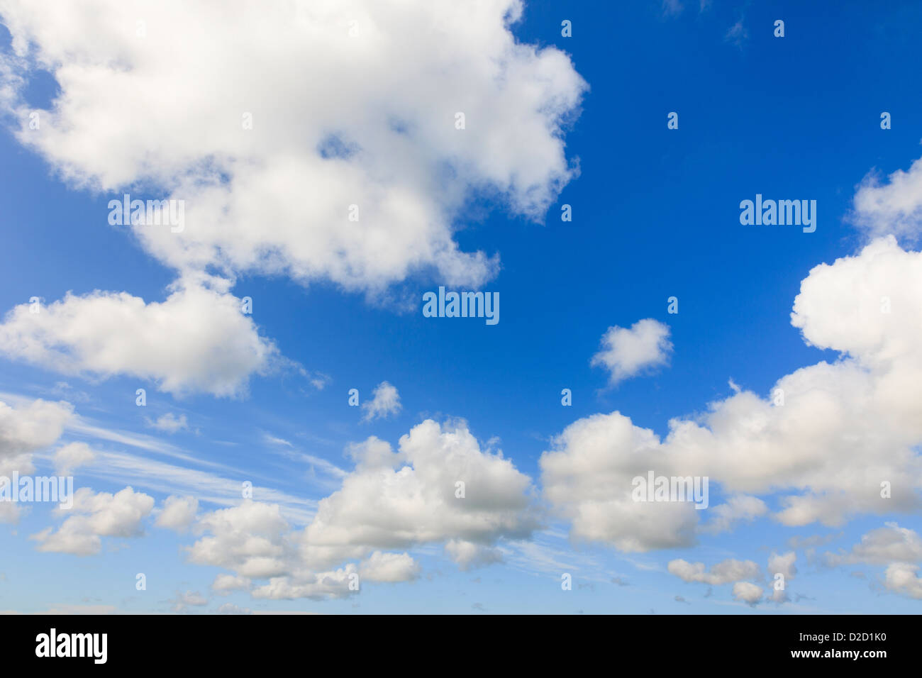 Blue sky with fluffy white cumulus clouds indicating clement summer weather in England UK Britain. Stock Photo