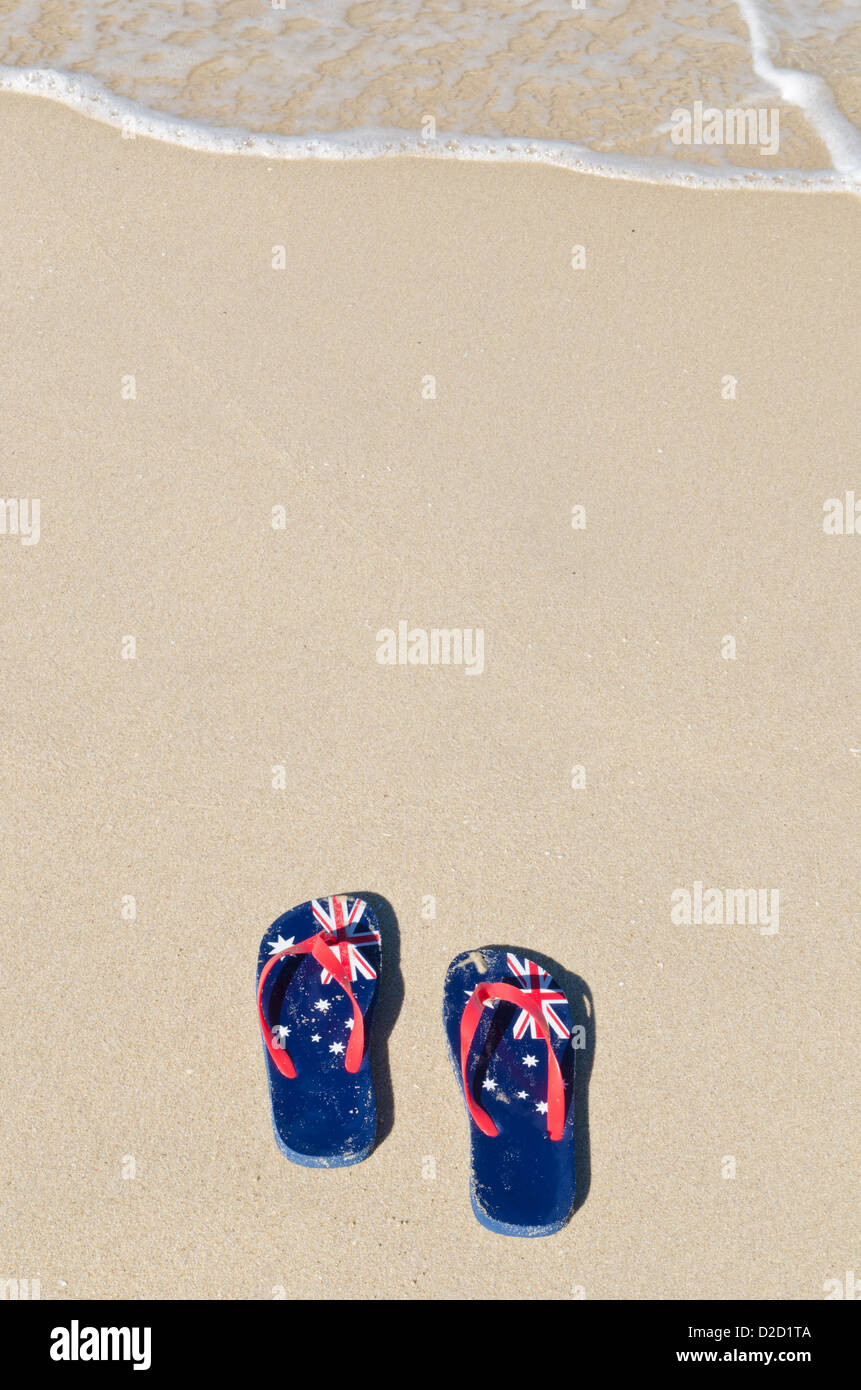 393f6b137c8664 Australia Day flip-flops with with an Australian flag print on a sandy beach  in Western Australia